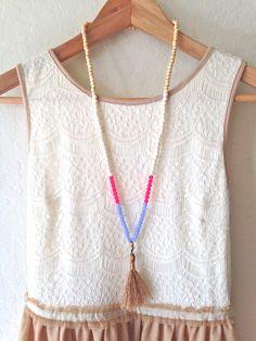 Beaded Tassel Necklace, Wood, Ceramic and Quartzite Beads, Black Tassel by DinosaurFood on Etsy https://www.etsy.com/listing/229645268/beaded-tassel-necklace-wood-ceramic-and