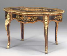 A NAPOLEON III GILT-METAL MOUNTED TULIPWOOD STAINED PEARWOOD AND MARQUETRY SERPENTINE CENTRE TABLE THIRD QUARTER 19TH CENTURY.