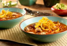 Mexican Tortilla Soup Recipe: This kicked-up soup features sautéed onions and spicy peppers combined with chicken, corn, tomatoes and black beans all simmered in a delicious broth. The result is an ultra-flavorful soup your family will love!