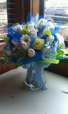 Diaper bouquet; would change to colors of shower/sprinkle