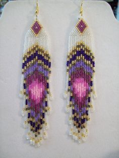 Native American Beaded Peacock Eye Pinks and Purples Earrings 5 1/2 in. long Shoulder Dusters. $35.00, via Etsy.