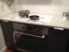 Super cool stove. It's a lot cooler in person, and the kitchen storage is amazing.