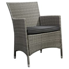 Perfect for your outdoor seating group or sunroom, this lovely arm chair showcases wicker-inspired details and a grey finish.  Produ...