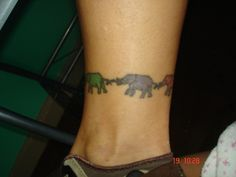 I love elephants so much. I'm thinking I'd like to get a small elephant tattoo, and this would be a good idea to get one like this for the people in my family (not on my ankle, b/c that'd hurt, maybe I'd have it wraping around my thigh)