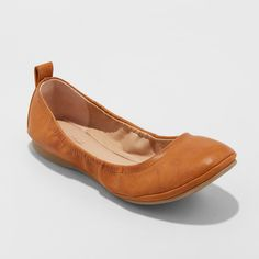 Dress up any outfit with this pair of Delaney Round-Toe Ballet Flats from  Universal Thread™. These ballet flats feature elastic sides that comfortably . 3a8b1a2bb068