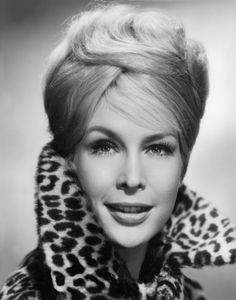 Barbara Eden's girlish charms are nicely set off by a collar that frames her vivid face.