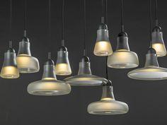 Black Interior - Brokis lights - Grey Mat Shadows are hanging lights. The designer Lucie Koldova and Dan Yeffet.