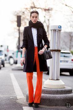 Orange trousers + long black jacket + white shirt + black scarf and purse