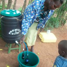 Woman showing how to filter their water source for clean safe water