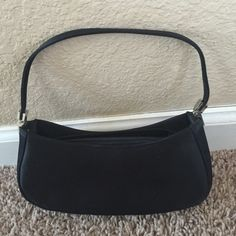 Small black satin cocktail purse Small black satin cocktail purse with silver hardware  and zipper. The Purse has been used a couple of times for prom  but is still very new and very clean. Bags Clutches & Wristlets