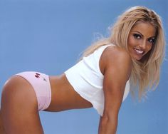 Trish Stratus - Why didn't she stay blonde? She's 100% unrecognizable with that ugly brown hair.