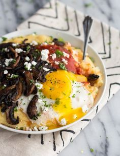 Polenta with Caramelized Mushrooms, Marinara and Fried Eggs and Goat Cheese
