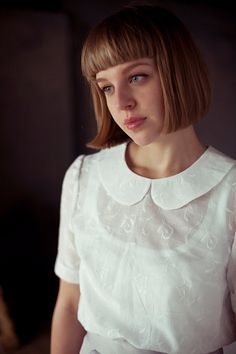 White Collared Blouse. I wore blouses like this when I was a child...they buttoned up the back.