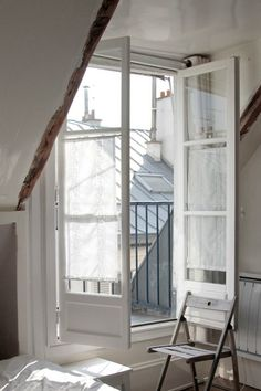 White European style casement windows with balcony and rooftops. wood and white 15