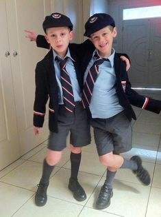 I am sold on the whole uniform thing.  In fact, I'll go as far as to say, the more formal the better.  Dare I declare... it sets a tone; it creates an atmosphere.  It makes boys acting naughty, still be, boys acting naughty; but they look extra adorable while doing it