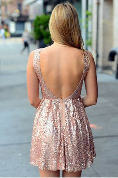 Add some glitz and glam to your life with our rose gold Sophia Dress! It's the perfect for dress holiday parties.