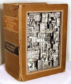 Check out the amazing work of artist Brian Dettmer.I can't imagine the time it takes to cut collages out of old books like this one below. Here's a link to his flickr account with some amazing shots of his work: http://www.flickr.com/photos/briandettmer/