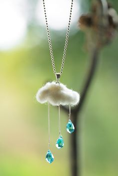 …if they were sparkly and blue, I'd would string them up and make something pretty like this beautiful necklace from The Wool Room with its felted wool cloud. But until crystals shaped like teardrops...