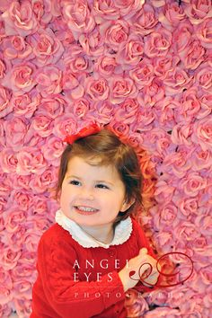 Little girl in red by a wall of roses.  Photography by Hilda Burke  http://www.angeleyesphotography.com/  http://www.angeleyesphotographyblog.com/