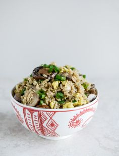 Portobello Fried Brown Rice 4 tablespoons olive oil 16 ounces sliced mushrooms 3 garlic cloves, minced 1/2 teaspoon freshly grated ginger 2 large eggs, lightly beaten 1 1/2 cups cooked + cooled brown rice 2 1/2 tablespoons low sodium soy sauce 1 tablespoon toasted sesame oil 2 teaspoons toasted sesame seeds 4 green onions, thinly sliced