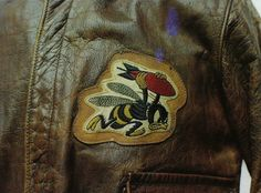 """Wee Willie,"" a bee carrying a red bomb, was the insignia of the 21st Bomb Squadron, 30th Bomb Group. The patch is sewn to the A-2 of Captain Earnest C. Pruett, who flew B-24 Liberators. #WWII #History #USAAF #BomberJackets"