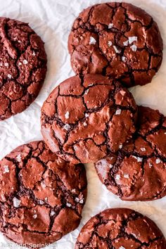 Can't choose between baking cookies or brownies? Bake these Brownie Espresso Cookies! They're brownies in cookie form! Perfect fudgy centers and crispy-crinkly tops, just like your favorite brownies. #justaddsprinkles #brownies #cookies #baking