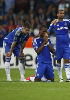 Drogba praying