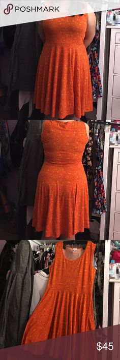 LuLaRoe Nicole sleeveless dress LuLaRoe Orange print Nicole dress. Altered to sleeveless, but done so beautifully as seen in pic 3. Size 2X in great condition. 21 inches armpit to armpit and 41 inches shoulder to hem, waist 18 inches. LuLaRoe Dresses Mini