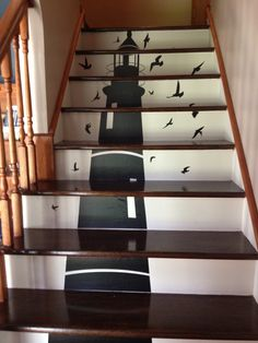 stained the tops, painted the back and added a vinyl lighthouse decal.  Love my new stairs!!