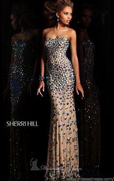 48 Sherri Hill Prom Dresses 2013. bonus she has a beautiful dark skin color. lucky