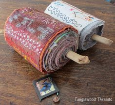Rolled up stitched journal -  Tanglewood Threads: 2012 Scratchings