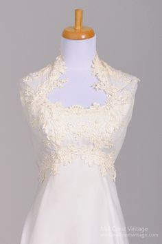 Designed in the 60's, this magnificent vintage wedding gown is done in a white poly chiffon with beautiful lace appliques in the bodice and is lined in aceta...