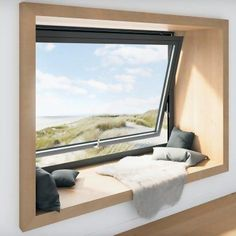 Unique pivoting window for ventilation. The perfect snug spot for soaking up some vitamin D Even without that view and just a good book it would be idyllic. Square Windows, Large Windows, Interior And Exterior, Interior Design, Window Benches, Modern Windows, Contemporary Windows, House Extensions, Window Design