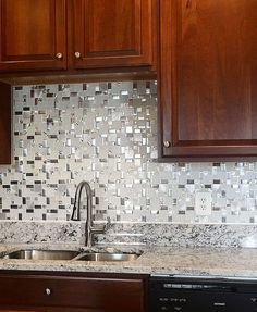 Modern look glass metal backsplash tile. Naturally water-resistant, glass and metal backsplash tile is impervious to stains and spills. Cheap Backsplash Tile, Backsplash Arabesque, Quartz Backsplash, White Kitchen Backsplash, Beadboard Backsplash, Stone Backsplash, Herringbone Backsplash, Penny Backsplash, Hexagon Backsplash