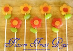 Fruit Flower pops. Use watermelon, cantelope and grapes. Cut flowers in both cantelope and watermelon. Cut circles out of the middle and then interlace watermelon centres with cantelope flowers and vice versa. Then place a grape on as a leaf. Use plastic lollypop sticks or wooden skewers as paper lolly pop sticks will absorb the moisture and will wilt.