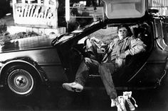 Director Robert Zemeckis in the Delorean time machine from Back to the Future.