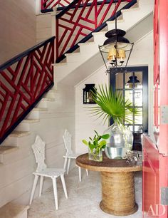 Pecky-cypress panels line the entrance hall, where a Directoire hanging lantern joins antique Tyrolean chairs and a table. Tour Alessandra Branca's Vacation Home in the Bahamas Photos Design Entrée, Design Vase, Deco Design, Design Ideas, Design Inspiration, Les Bahamas, Harbour Island Bahamas, Pecky Cypress, Bahamas Vacation