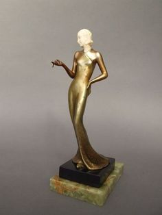 Chryselaphantine Lady by Lorenzl   Stunning Austrian bronze lady in evening dress posing and smoking her cigarette. Her head is made of carved ivory and she was designed by Lorenzl in the 1920's.