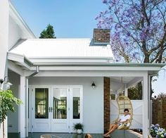 The Queenslander-style feature wall is VJ panelling from Subiaco Restoration. Bed, bench, stool, throw and rug, Cranmore Home. Duplex Design, House Design, Edwardian Architecture, Weatherboard House, Recycled Brick, Facade House, House Facades, Edwardian House, Melbourne House