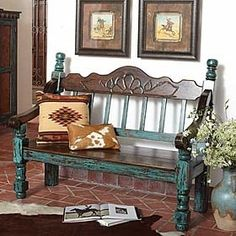 Western turquoise bench, cowhide, and cowboy paintings... perfect western decor.