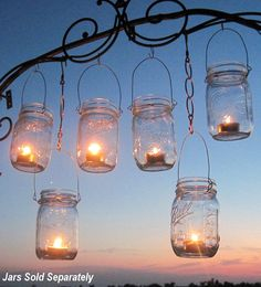 Mason Jar Lanterns...would love to try this with DIY colored jars :)