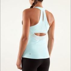 Lululemon make it count tank light blue This tank is so cute with the mesh panels. I would consider it to be a light seafoam blue color. Very beautiful! Lightly used with a small seam coming undone. Doesn't alter the top in anyway and could be easily fixed for free at any Lululemon store. lululemon athletica Tops