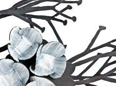 Twiggy Turnip Weed broochNina Ellis  Mild steel, sterling silver, white enamel paint  (via e.g.etal)