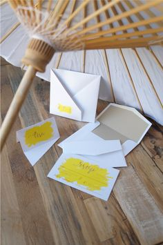 Yellow paint splatter custom wedding invitation | Origami inspired wedding invitations | Hanabi fold from my signature range, by A Tactile Perception | Parasol hire from A Day to Remember Event Hire