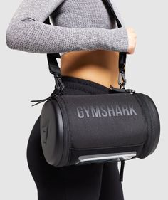 THE GYMSHARK LIFTING CLUB ⁃ One main entry ⁃ Zip 'wet pocket' to end ⁃ Side panel with functional touchscreen for phone ⁃ Adjustable carry strap with padded handle ⁃ Reinforced PU base ⁃ YKK hardware ⁃ Matte printed Gymshark logo to side ⁃ Embossed Gymshark logo to base ⁃ Main: Polyester & PVC. Lining: Polyester & PU. ⁃ Length: 17cm. Height: 25cm. Width: 17cm. Volume: 6L (approx). ⁃ Label Colour: BlackWe can't make you workouts easier, but we can make them more convenient. The LC Bag is Lifting Straps, Underwear Shop, Running Accessories, Gym Essentials, Gym Style, Carry On Bag, Sport Shorts, Gym Bag, Leggings Are Not Pants