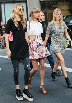 Taylor Swift's street style is on point! See more pictures of her outing with Gigi Hadid and Martha Hunt.
