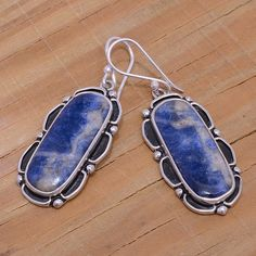 """‼️Clearance‼️Large Sterling & Sodalite Earrings Stamped """"Mexico 925"""".   This is not a stock photo. The image is of the actual article that is being sold  Sterling silver is an alloy of silver containing 92.5% by mass of silver and 7.5% by mass of other metals, usually copper. The sterling silver standard has a minimum millesimal fineness of 925.  All my jewelry is solid sterling silver. I do not plate.   Hand crafted in Taxco, Mexico.  Will ship within 2 days of order. Jewelry Earrings"""