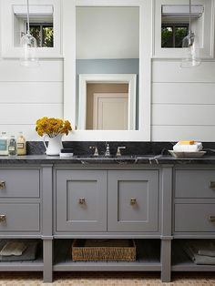 Classic colors give this bathroom a crisp modern feeling. Browse more of our top bathroom vanity picks here: http://www.bhg.com/bathroom/vanities/bathroom-vanity-picks/?socsrc=bhgpin090414classiccolors&page=1