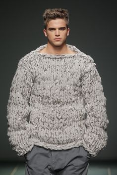 It's a throw blanket, but a sweater..... and not as embarrassing as a Snuggie.