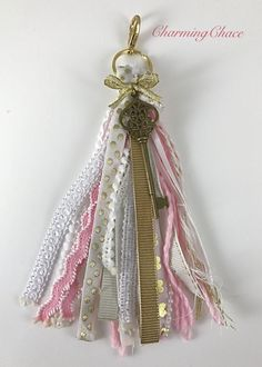 Key chain, tassel, purse charm, planner charm, etc in soft pink by CharmingChace on Etsy https://www.etsy.com/listing/503037884/key-chain-tassel-purse-charm-planner